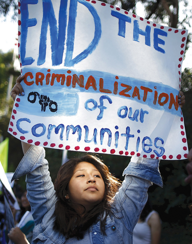 DETENTION PROTEST. An immigration advocate demonstrates in Los Angeles on July 10.