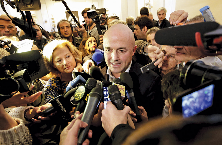 FULL PRESS. Italian journalist Gianluigi Nuzzi is surrounded by the media after a  news conference for his new book Merchants in the Temple on Nov. 4.