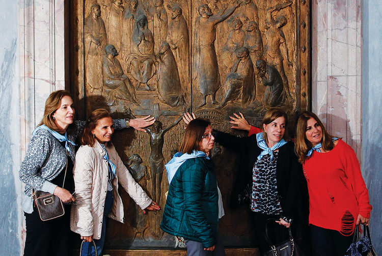 Door Stop. Visitors touch the Holy Door at the Basilica of St. Paul Outside the Walls on Nov. 19.