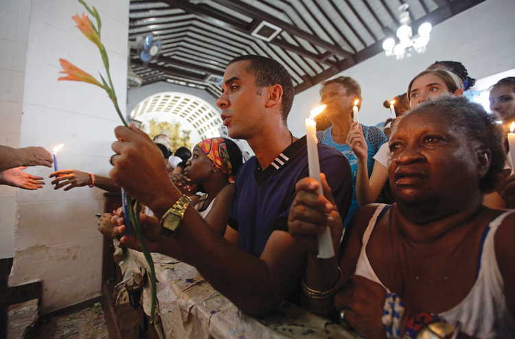 At prayer in Cuba