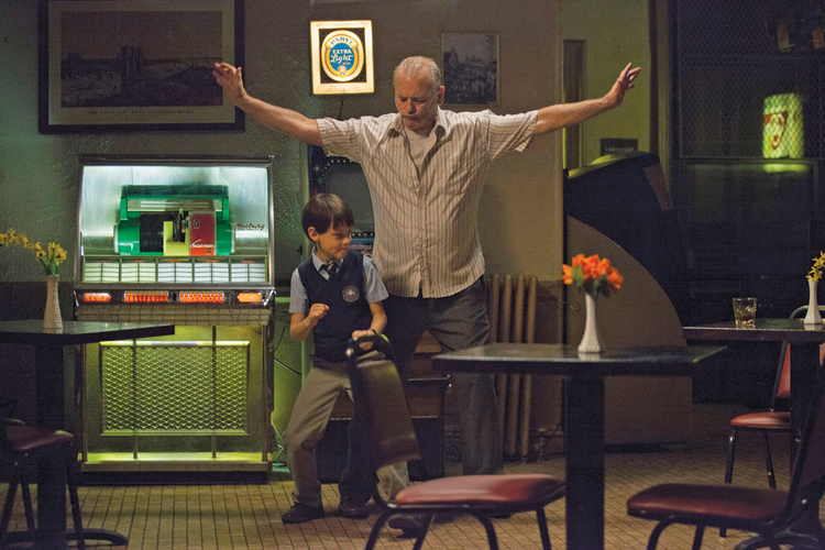"BAD BABYSITTER. Jaeden Lieberher and Bill Murray in ""St. Vincent"""