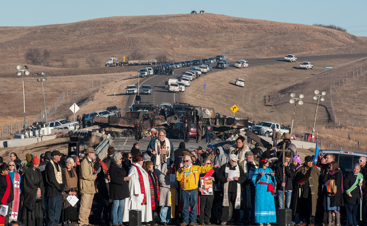 Clergy of many faiths from across the United States participate in a prayer circle on Nov. 3, 2016, in front of a bridge in Standing Rock, N.D., where demonstrators confront police during a protest of the Dakota Access pipeline. (CNS photo/Stephanie Keith, Reuters)