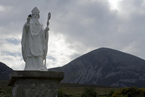 Statue of Saint Patrick at the base of Ireland's Holy Mountain named after him, Croagh Patrick, in County Mayo, the West of Ireland