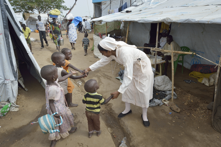 Sister Suja Francis, a member of the Daughters of Mary Immaculate, greets children inside a United Nations camp for internally displaced families in Juba, South Sudan, on April 1.