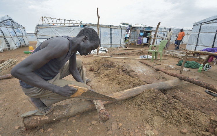 A man constructs a shelter inside a U.N. base in Juba, South Sudan, March 7. Church leaders in South Sudan are trying to breathe new life into their country'­s stalled peace talks. (CNS photo/Paul Jeffrey)