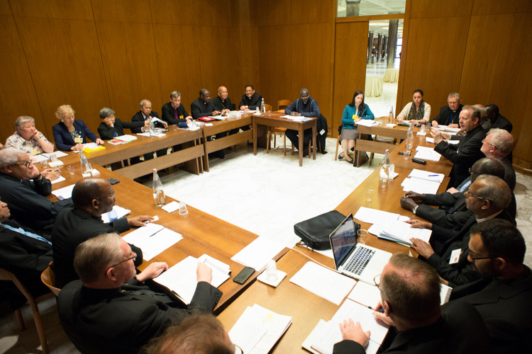 English-speaking delegates at the Synod of Bishops on the family meet to discuss the working document at the Vatican, Oct. 19 (CNS photo/L'Osservatore Romano).