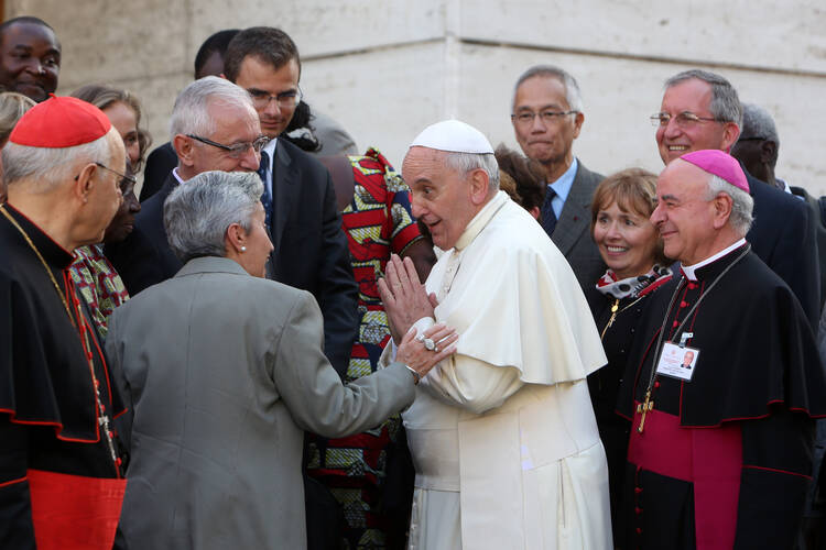 Pope Francis greets auditors of extraordinary Synod of Bishops on family as he arrives for afternoon session at Vatican, Oct. 10