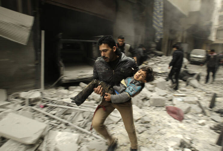 Rushing an injured child from an air strike in Aleppo