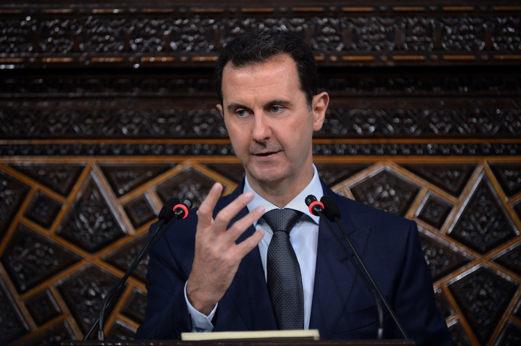 Syrian President Bashar Assad speaks in Damascus on June 7. Removing Assad from power has been a U,S, objective even before the rise of ISIS.  (SANA via AP)