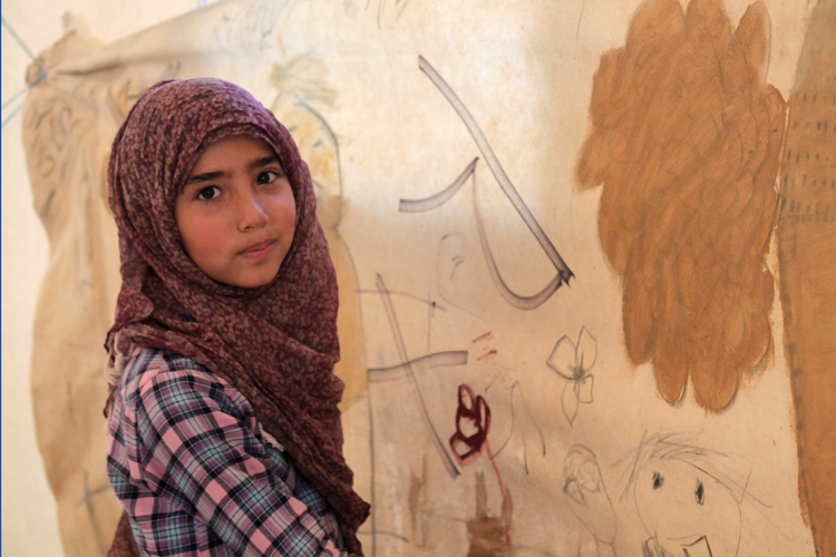 Desert refuge. A Syrian girl in Jordan's Zaatari refugee camp girl paints her vision of a perfect place to live.
