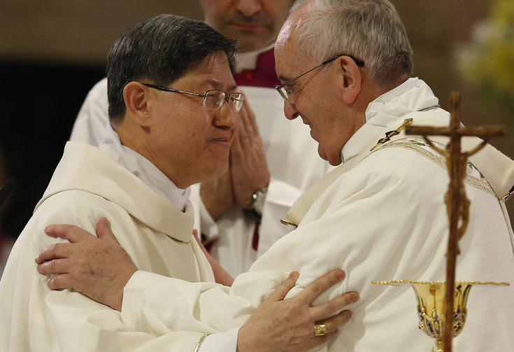 Pope Francis greets Cardinal Luis Antonio Tagle of Manila, Philippines, at the sign of peace while celebrating Mass at the city's Cathedral of the Immaculate Conception on Jan. 16. (CNS photo/Paul Haring)