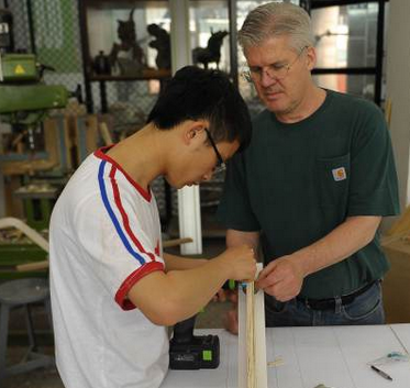 Fr. Terry Curry, SJ, helps Cheng Yuhai, a grad student at Tsinghua University, with his thesis project. (In Our Company Jesuit newsletter, February 13, 2014)