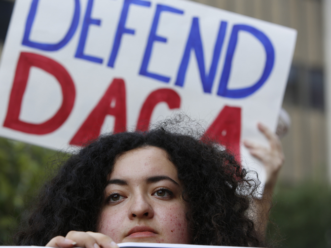 "Loyola Marymount University student and ""Dreamer"" Maria Carolina Gomez joins a rally in support of the Deferred Action for Childhood Arrivals, or DACA, program outside the Edward Roybal Federal Building in Los Angeles on Sept. 1, 2017. (AP Photo/Damian Dovarganes) (Caption amended by RNS)"