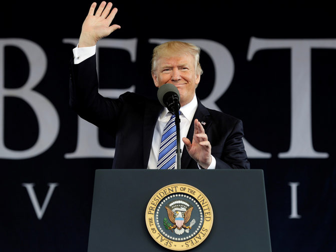 President Donald Trump waves before delivering keynote address at Liberty University's commencement in Lynchburg, Virginia, U.S., on May 13, 2017. Photo courtesy REUTERS/Yuri Gripas