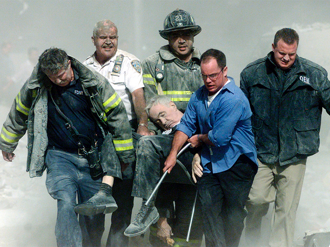 Rescue workers carry fatally injured New York City Fire Department chaplain, the Rev. Mychal Judge, from the wreckage of the World Trade Center in New York City on Sept. 11, 2001. Photo courtesy of REUTERS/Shannon Stapleton