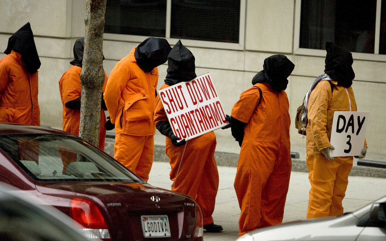 Protesters against the Guantanamo Bay prison line up outside the transition office of U.S. President-elect Barack Obama in 2009.