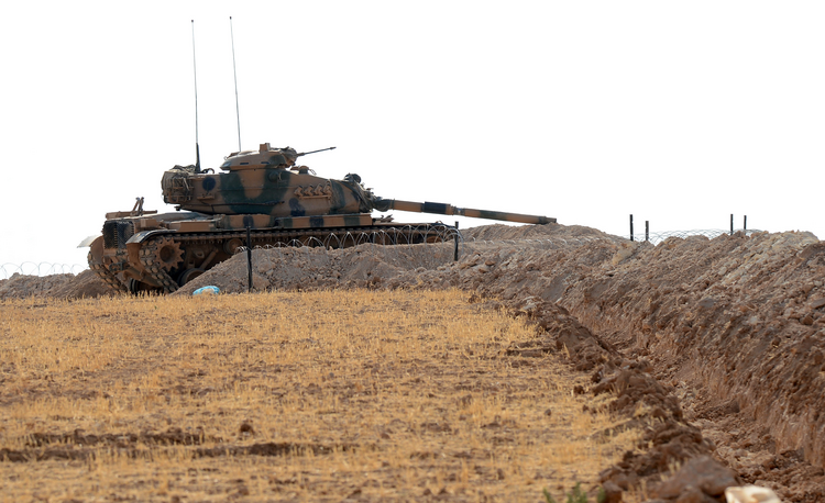 A Turkish tank is stationed near the Syrian border, in Karkamis, Turkey, Monday, Aug. 29, 2016. (Ismail Coskun/IHA via AP)