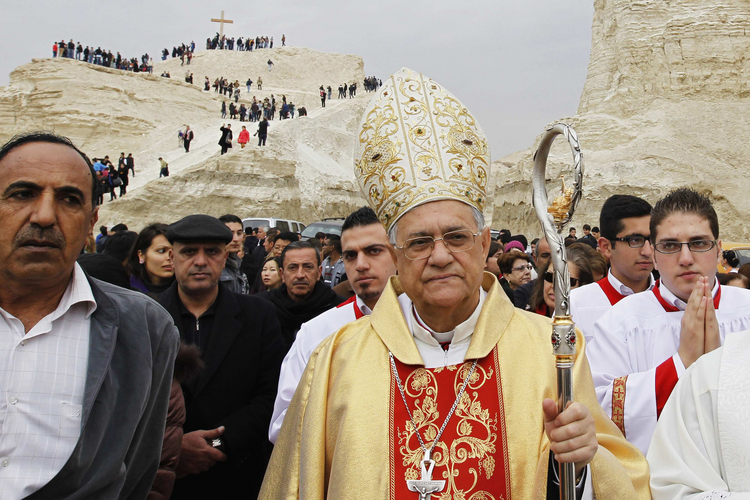 Latin Patriarch Faoud Twal of Jerusalem leads an annual pilgrimage at a baptism site on the Jordan River on Jan. 10..