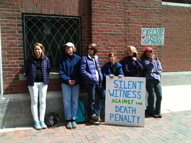 Death penalty opponents stood in front of the U.S. District Court in Boston on Monday.