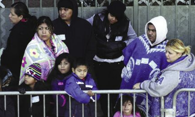 Redistributing Wealth?Families wait in line for the Los Angeles Mission's Christmas meal service.