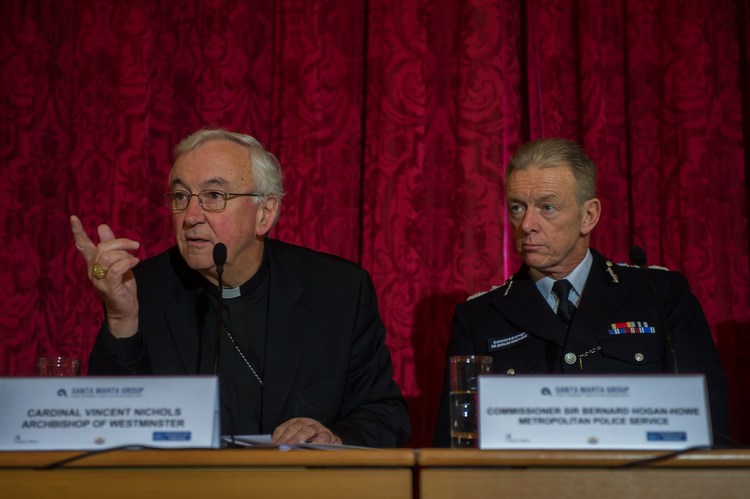 Cardinal Vincent Nichols of Westminster speaks during a human trafficking conference in London, Dec. 6, 2014.