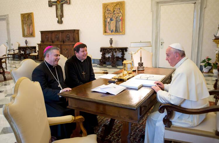 Archbishop Carballo and Cardinal Braz de Aviz with Pope Francis in an October meeting.