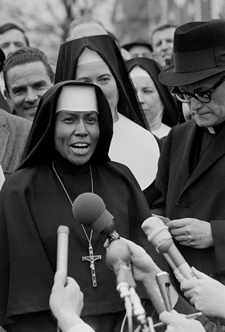 Sister Mary Antona Ebo, of the Sisters of St. Mary in St. Louis, talks to the media about black voting rights during a civil rights protest in Selma, Ala., on March 10, 1965.