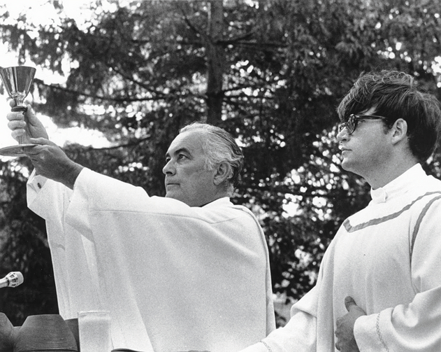 AT THE HELM. Theodore M. Hesburgh, C.S.C., left, as principal celebrant at an outdoor Mass for students on Main Quad of the Notre Dame campus, ca. 1977