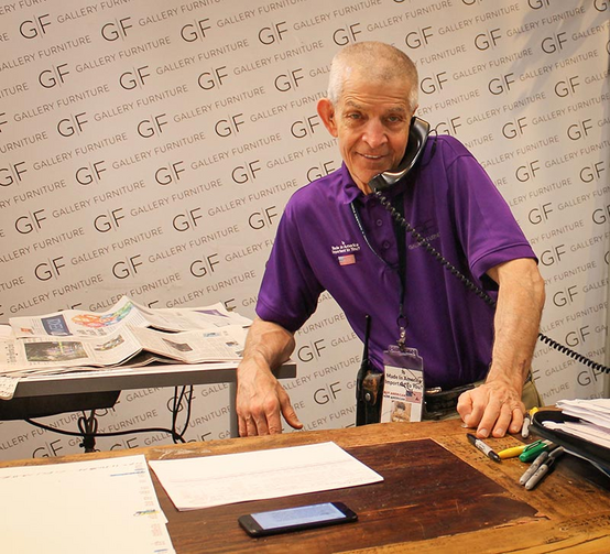 "Jim ""Mattress Mack"" McIngvale answers the telephone at his original Gallery Furniture store in Houston on Sept. 2, 2017. McIngvale, motivated by his Catholic faith, dispatched trucks to rescue Harvey flooding victims and opened his stores as shelters to hundreds of evacuees and Texas Army National Guard troops. (RNS photo by Bobby Ross Jr.)"