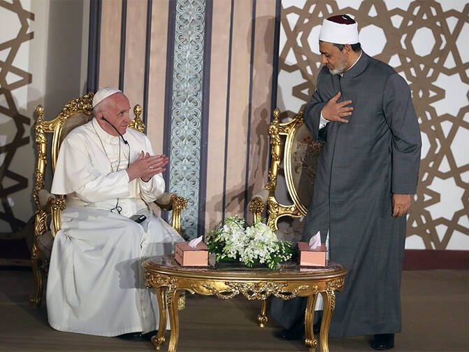 Pope Francis greets Al-Azhar's Grand Imam Ahmed al-Tayeb during a meeting in Cairo on April 28, 2017. Photo courtesy of Reuters/Mohamed Abd El-Ghany
