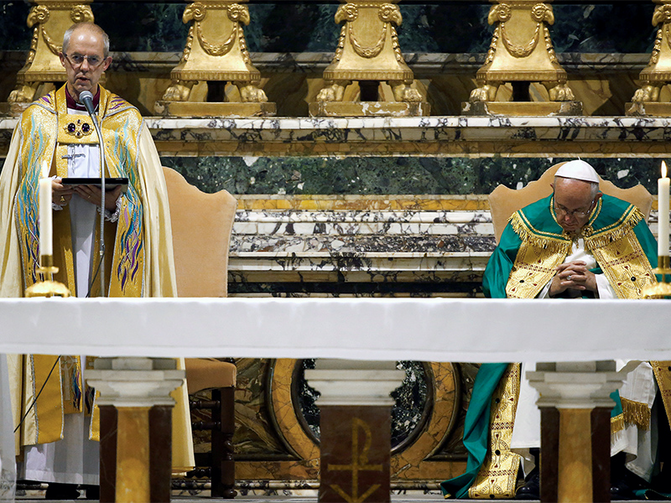 Archbishop of Canterbury Justin Welby, left, speaks, flanked by Pope Francis, during vespers prayers at the monastery church of San Gregorio al Celio in Rome, Italy, on Oct. 5, 2016. Photo courtesy of Reuters/Tony Gentile