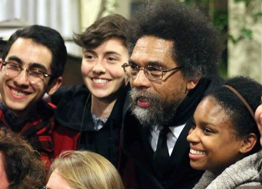 Dr. Cornel West poses with students after his talk at Maryhouse Catholic Worker on Nov. 8, 2013. Photo courtesy of Palina Prasasouk.