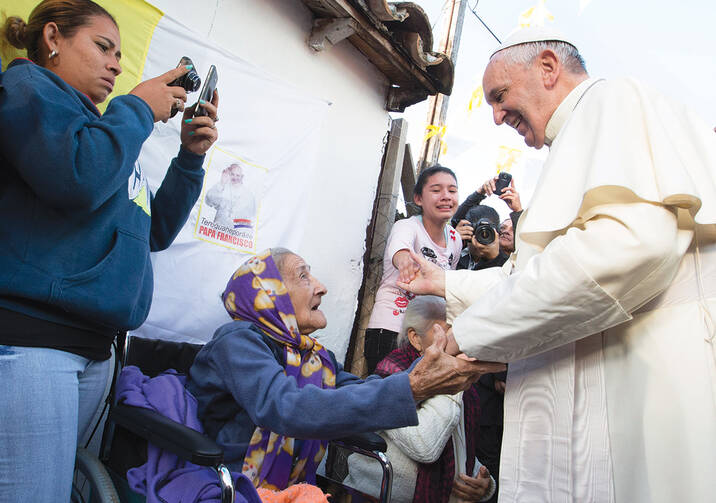 HUMANE TOUCH. Pope Francis with people of Banado Norte, a poor neighborhood in Asuncion, Paraguay, July 12.