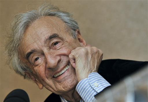 In this Dec. 10, 2009 file photo, Elie Wiesel smiles during a news conference in Budapest, Hungary (AP Photo/Bela Szandelszky, file).