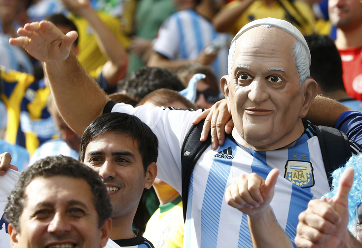 An Argentina fan wears a mask of Pope Francis as he attends the 2014 World Cup Group F final June 25, 2014, between Argentina and Nigeria at the Beira Rio stadium in Porto Alegre, Brazil. (CNS photo/Stefano Rellandini, Reuters)
