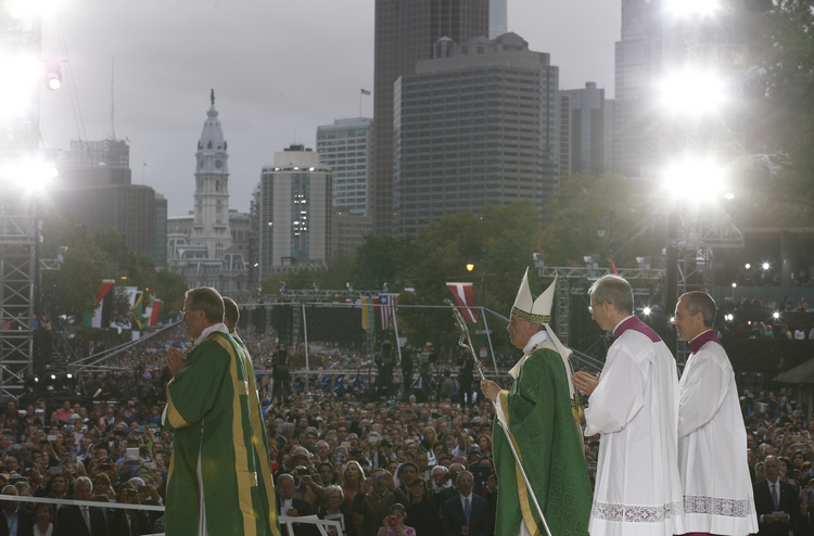Pope Francis leaves in procession after celebrating the closing Mass of the World Meeting of Families on Benjamin Franklin Parkway in Philadelphia, Sept. 27 (CNS photo/Paul Haring).