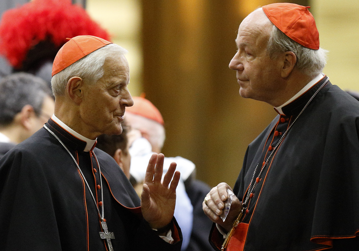 Cardinal Donald W. Wuerl of Washington talks with Cardinal Christoph Schonborn of Vienna as they leave the opening session of the Synod of Bishops on the family at the Vatican, Oct. 5. (CNS photo/Paul Haring).