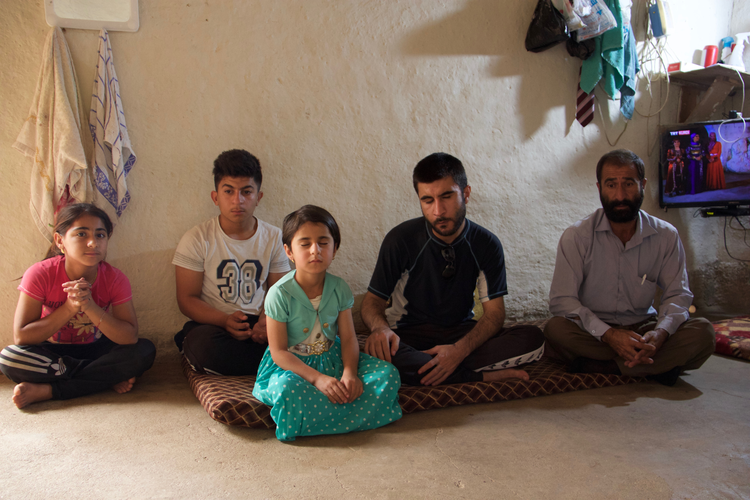 Image: A Yazidi family in a temporary shelter in Iraq. (Kevin Clarke)