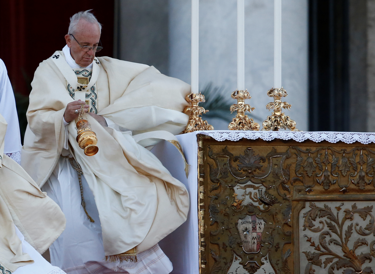 Pope Francis celebrates Mass on the feast of Corpus Christi June 18 outside Rome's Basilica of St. John Lateran. (CNS/Tony Gentile, Reuters)