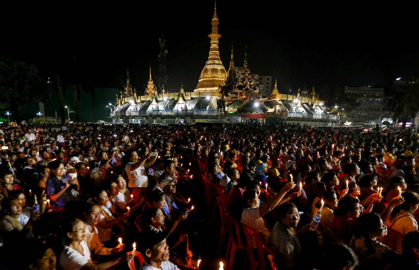 People hold candles during an Interreligious Gathering of Prayer for Peace in Yangon, Myanmar, Oct. 31 (CNS photo/Lynn Bo Bo, EPA).