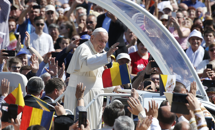 Pope Francis greets the crowd before celebrating a Divine Liturgy and the beatification of seven martyred bishops of the Eastern-rite Romanian Catholic Church at Liberty Field in Blaj, Romania, June 2, 2019. (CNS photo/Paul Haring)