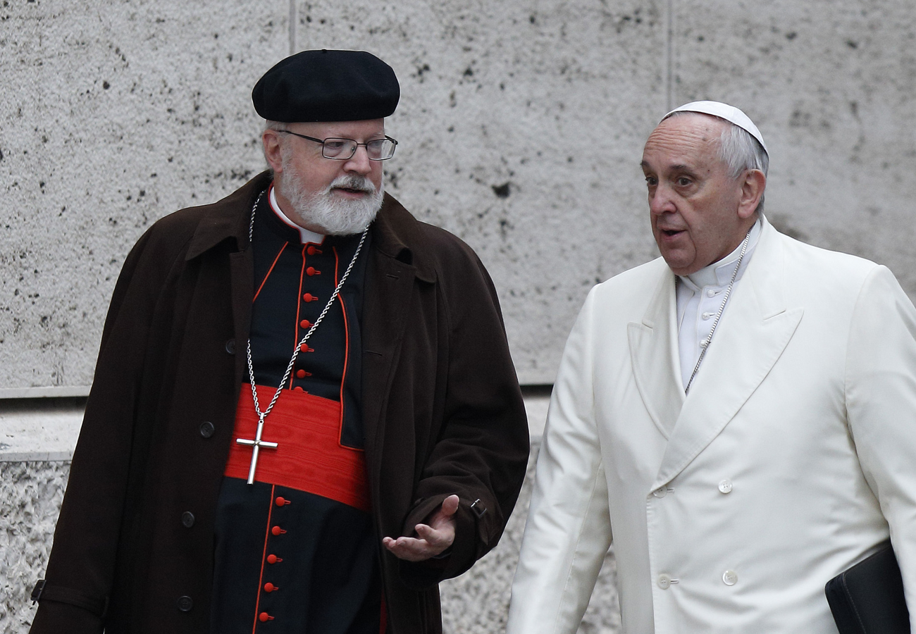 Pope Francis talks with Cardinal Sean P. O'Malley of Boston, president of the Pontifical Commission for the Protection of Minors, as they arrive for a meeting in the synod hall at the Vatican in this Feb. 13, 2015, file photo. (CNS photo/Paul Haring)