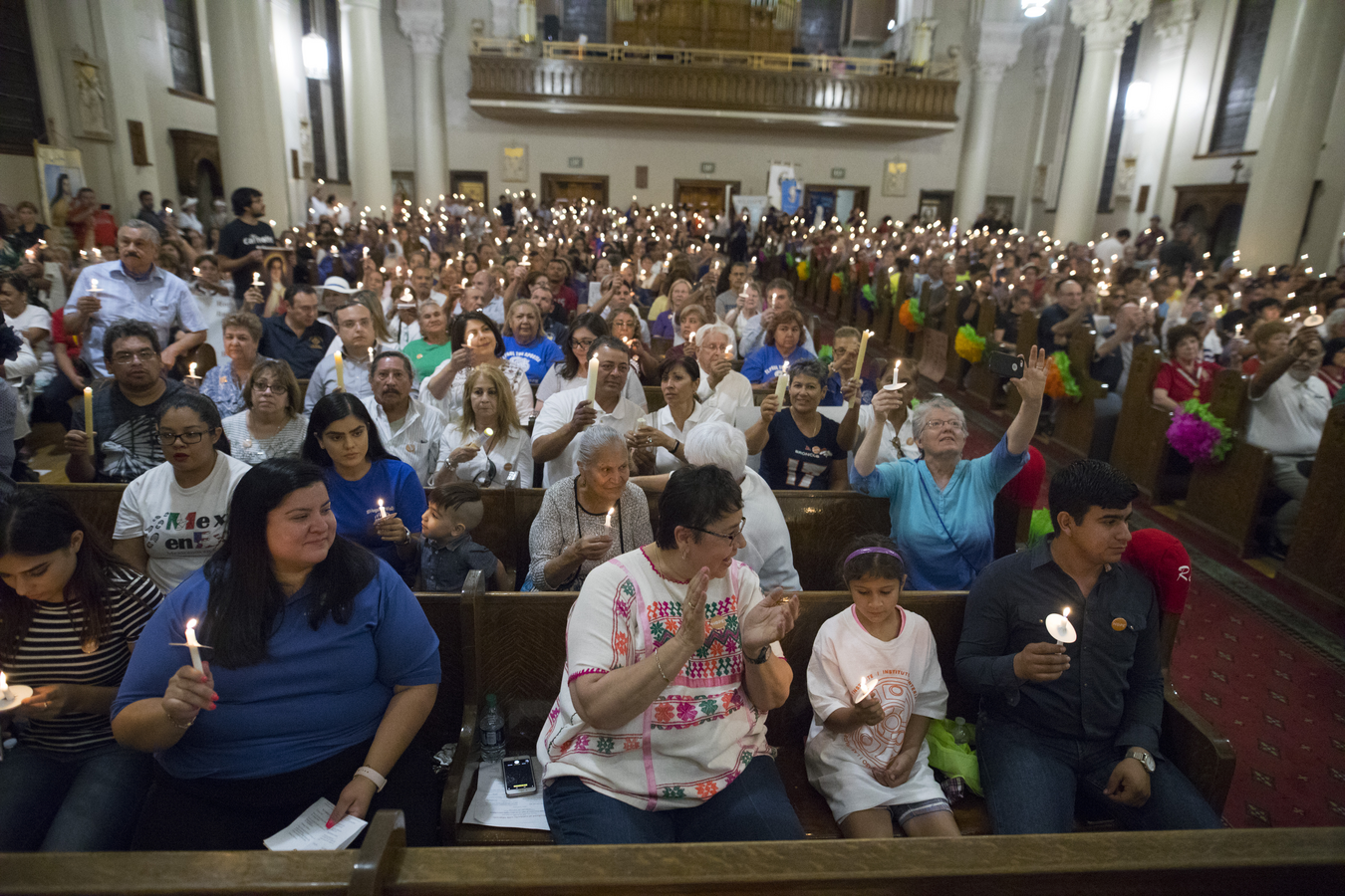 Worshippers attend a candlelight vigil on July 20 at St.Patrick's Cathedral in El Paso, Texas, following an immigration march and rally. (CNS photo/Jorge Salgado)