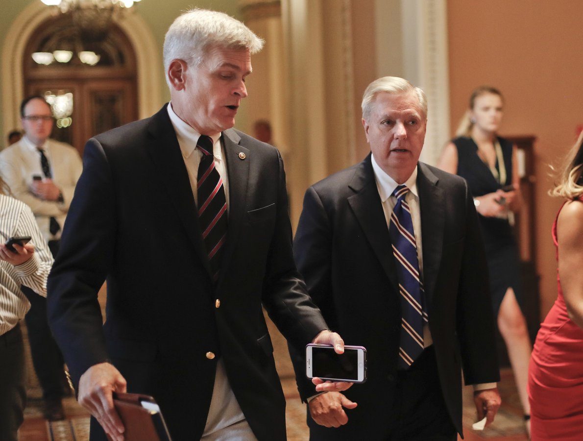 Sen. Bill Cassidy, R-La., left, and Sen. Lindsey Graham, R-S.C., right, talk while walking to a meeting on Capitol Hill in Washington in July. Senate Republicans are planning a final, uphill push to erase President Barack Obama's health care law. But Democrats and their allies are going all-out to stop the drive. (AP Photo/Pablo Martinez Monsivais, File)