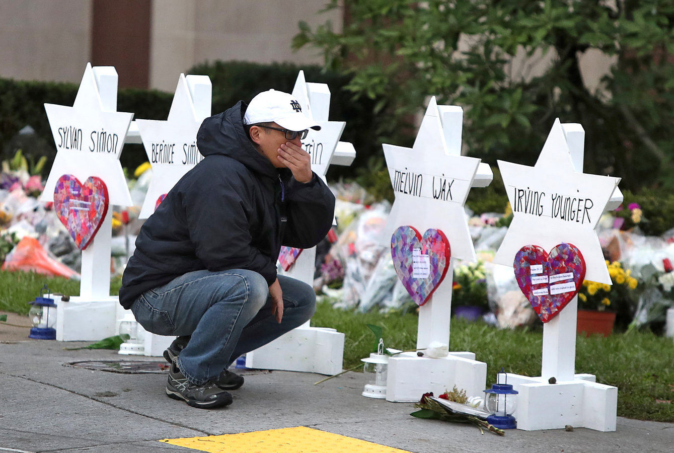 A young man on Oct. 29 at a makeshift memorial outside the Tree of Life synagogue in Pittsburgh. (CNS photo/Cathal McNaughton, Reuters)