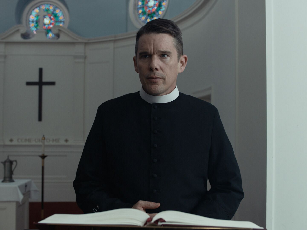 "Reverend Toller is a cleric cut from the cloth of Graham Greene's ""whiskey priest"" (photo: A24)."