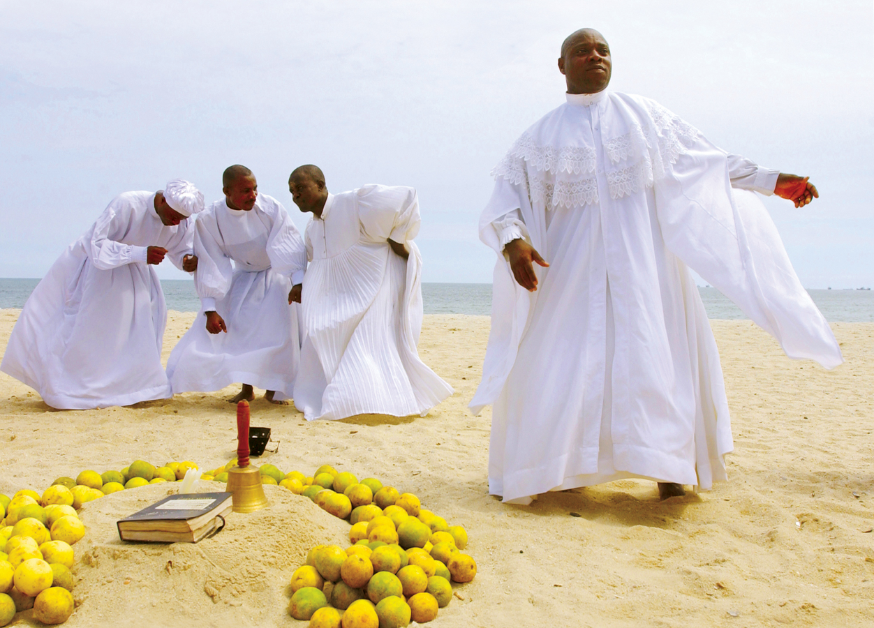Evangelical Christians pray together on Bar Beach in Lagos, Nigeria September 28, 2003. (Getty Images)