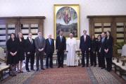 U.S. President Obama and delegation pose with Pope Francis during private audience at Vatican.