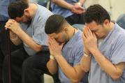 Prison inmates at Curran-Fromhold Correctional Facility in Philadelphia pray during a Mass in mid-January. Pope Francis has a planned visit to the prison Sept. 27 during his two-day visit to the city. (CNS photo/Sarah Webb, CatholicPhilly.com)
