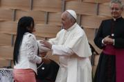 Pope Francis greets a young woman who gave a testimonial during a meeting with representatives of schools and universities at the Pontifical Catholic University of Ecuador in Quito July 7. (CNS photo/Paul Haring)